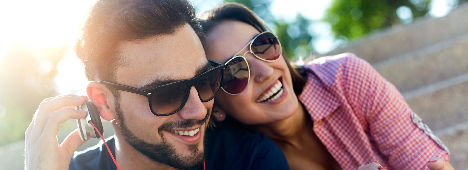 couple in sunglasses laughing